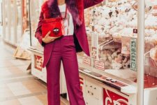 09 a fuchsia pantsuit with some colorful faux fur, white shoes, a printed tee and a whimsical red bag