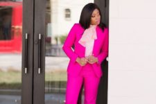 09 a hot pink pantsuit, a blush blouse with a large bow and bright floral shoes for a work day