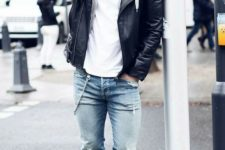 09  a spring look with a white tee, a grey hoodie, blue ripped jeans, white sneakers and a black leather jacket