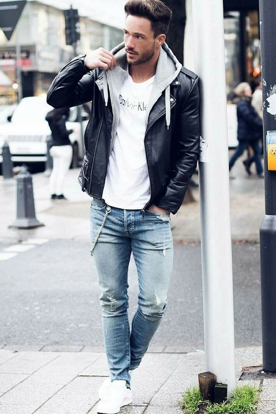 a spring look with a white tee, a grey hoodie, blue ripped jeans, white sneakers and a black leather jacket