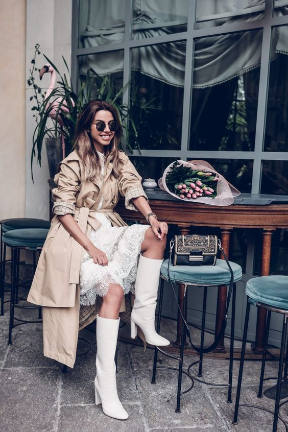 a white lace knee dress, white boots, a camel trench for a girlish spring look