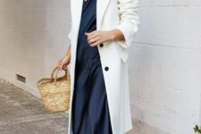10 a minimalist look with a black silk slip midi dress, a white trench, white sneakers and a basket