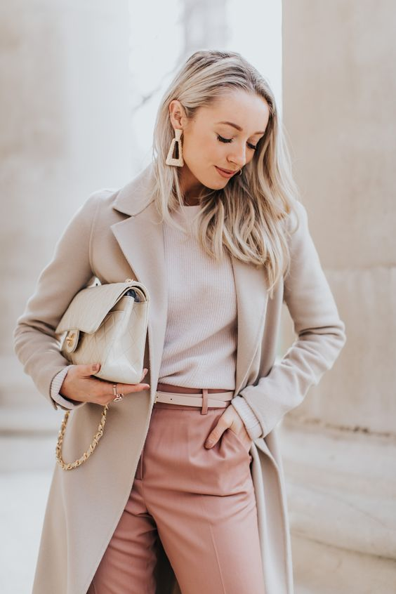 a neutral work look with a white top, pink pants, a neutral coat, a neutral bag and statement earrings