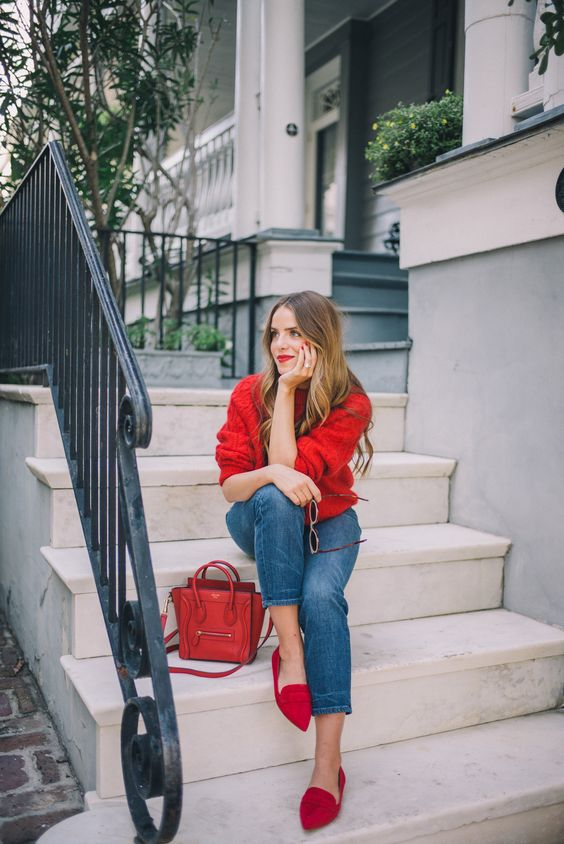 a red oversized sweater, blue straight jeans, red suede flats, a red bag for Valentine's Day