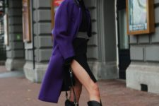 10 black knee boots, a black dress with a side slit, a purple coat and a black bag for a contrasting look