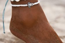 10 nice beachy anklets with white shells on a turquoise thread and white beads plus a turtoise
