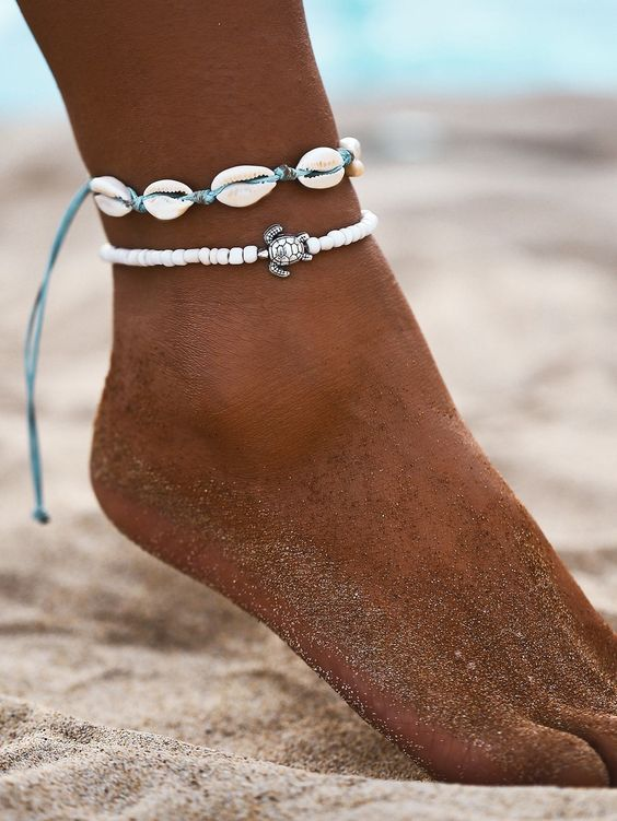 nice beachy anklets with white shells on a turquoise thread and white beads plus a turtoise