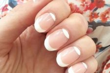 11 oval French nails with a double tip on contrarious sides of the nails is a bold and fresh idea