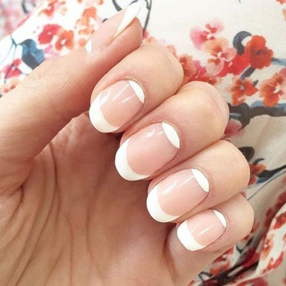 oval French nails with a double tip on contrarious sides of the nails is a bold and fresh idea