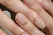 12 a contrarious micro French manicure done in blush and with gold curves is a chic and bold idea