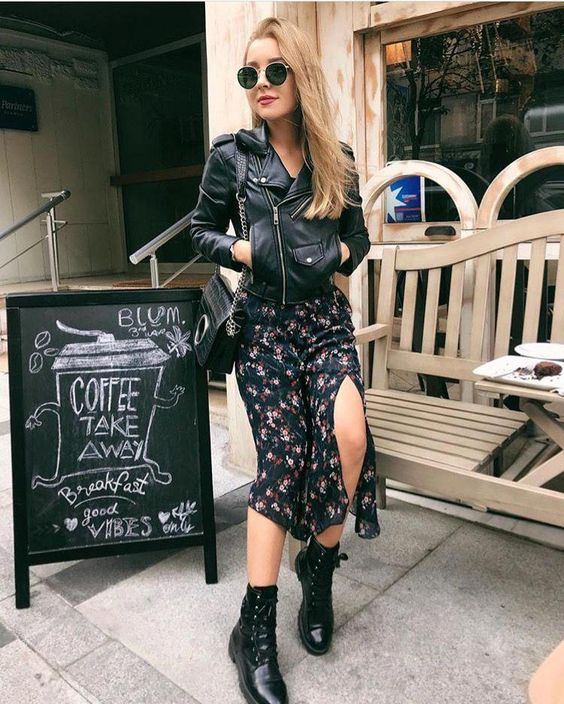 a dark floral midi dress, a black leather jacket, a black bag and black boots for a bold look