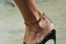12 a gold Gucci chain anklet is a statement and veyr trendy idea to wear with your spring and summer looks