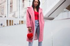 12 a red top, blue straight jeans, white sneakers, a pink faux fur coat and a red heart-shaped bag