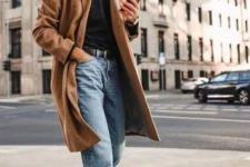 12 a winter look with a black turtleneck, light blue jeans, black boots and a classic camel coat