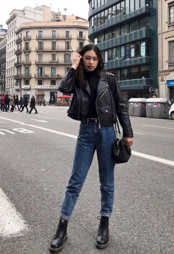 a black turtleneck, a black leather jacket, blue jeans, black boots and a black bag for spring
