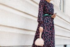 14 a modern spring outfit with a dark floral midi dress, a blush mini bag and colorful trainers