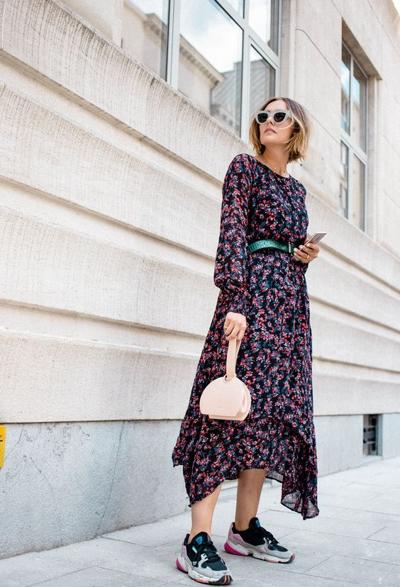 a modern spring outfit with a dark floral midi dress, a blush mini bag and colorful trainers