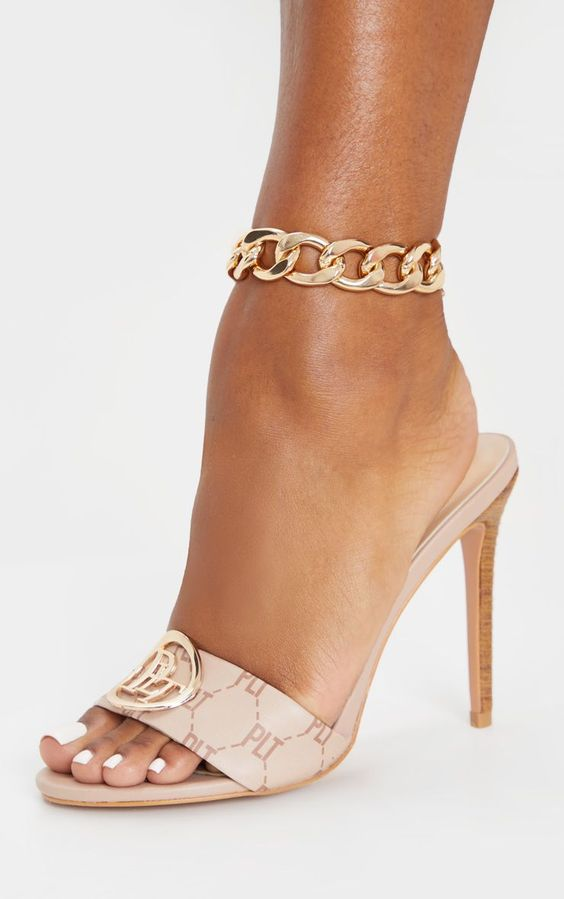 a super chunky chain choker anklet combines several trends   chunky chains and chokers