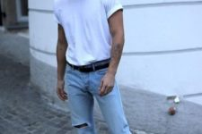 14 a trendy spring-summer look with a white tee, blue ripped jeans, black sneakers and white socks