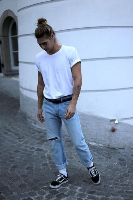 a trendy spring summer look with a white tee, blue ripped jeans, black sneakers and white socks
