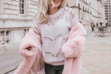 14 a white embellished sweater, black leather pants, a pink faux fur coat for really a cold day
