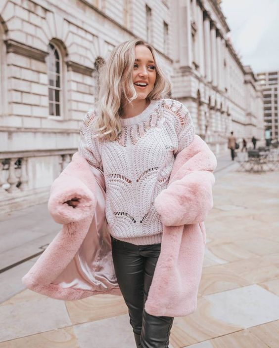 a white embellished sweater, black leather pants, a pink faux fur coat for really a cold day