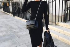 15 a black midi dress, a black leather coat, a black bag and combat boots for a bold look