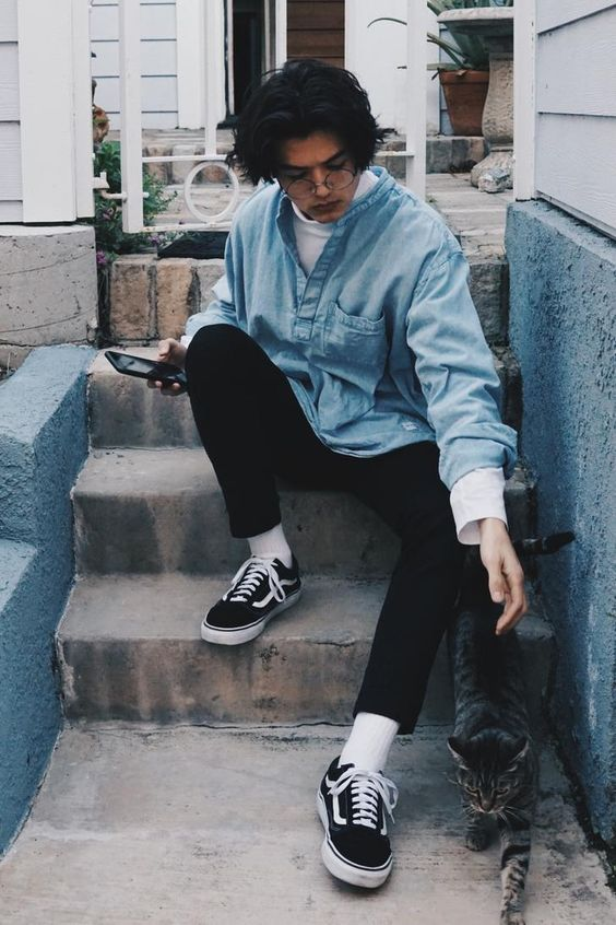 a double denim look with a white shirt, light blue chambray shirt, black jeans, black sneakers