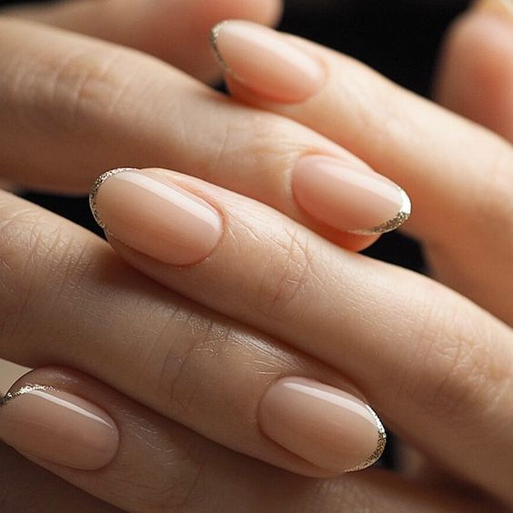 micro French nails with white and glitter tips look super romantic, chic and refined