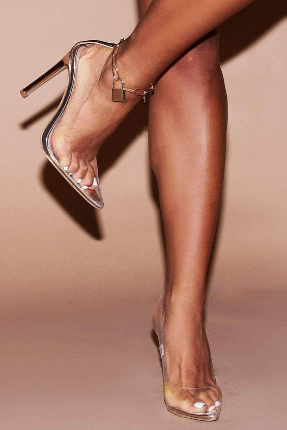 sheer heels paired with a chunky chain anklet with a lock for a bold statement and a trendy look