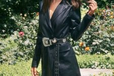 Emilie Ratajkowski wearing a black leather blazer dress with an embellished belt looks wow