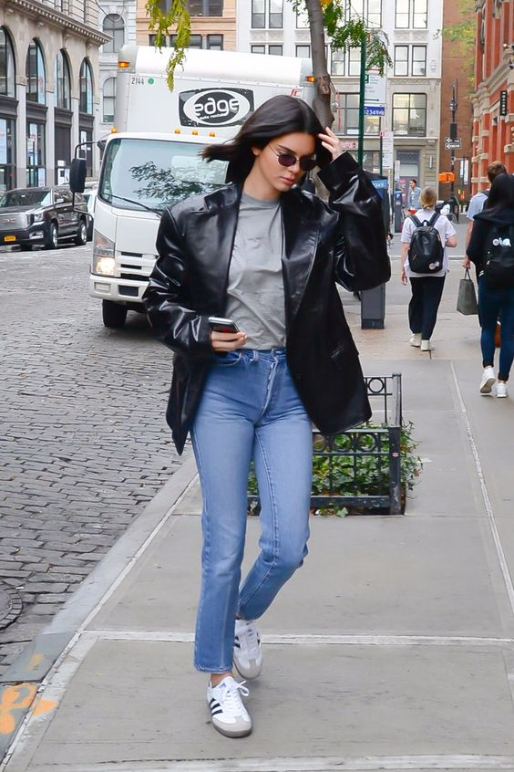 grey tee, blue jeans, white sneakers