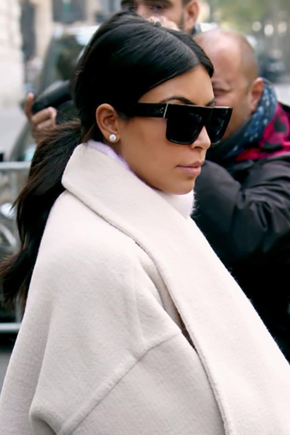 Kim Kardashian wearing black D-frame sunglasses to look edgy and bold
