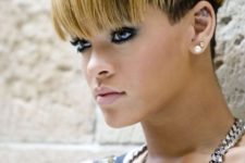 Rihanna rocking a mushroom haircut with layers – dark and blonde ones on top
