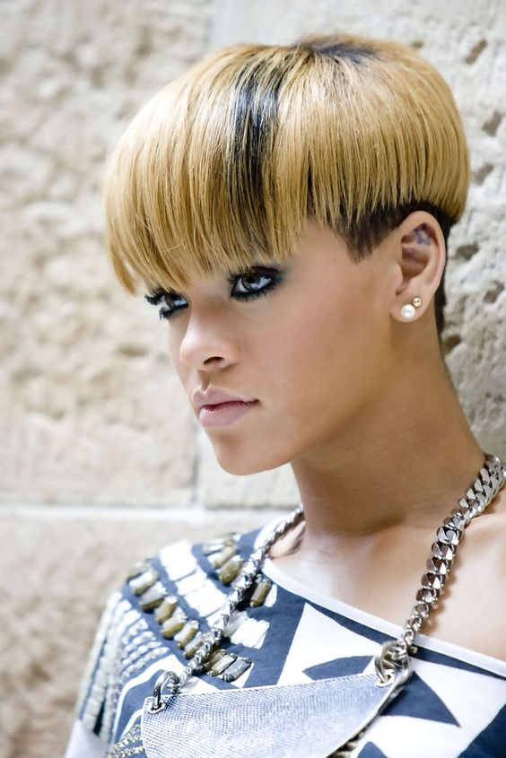Rihanna rocking a mushroom haircut with layers - dark and blonde ones on top