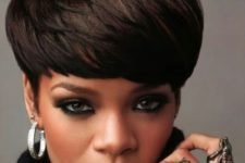 Rihanna wearing a dark bowl haircut looks wow and very bold and chic