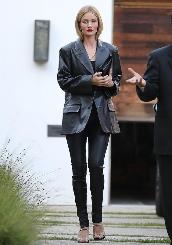 Rosie Huntington-Whiteley wearing black leather leggings, a black tee, a black leather blazer and embellished shoes