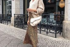 With beige loose sweater, white bag and sneakers