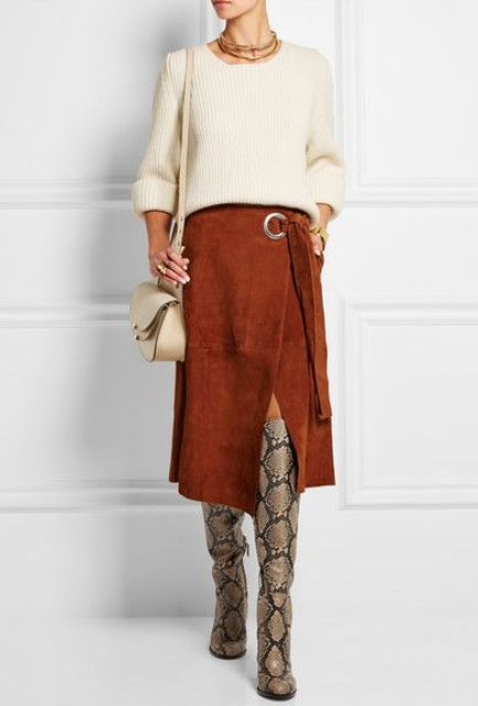 With beige sweater, beige bag and burnt orange wrapped midi skirt
