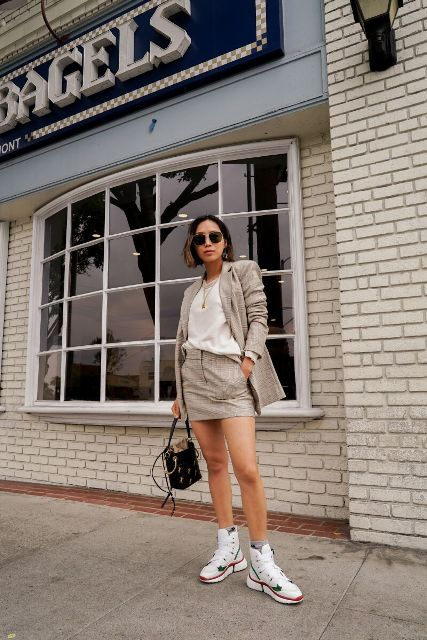 With beige top, checked long blazer, mini bag and red, green and white sneakers