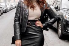 With beige turtleneck and black leather jacket