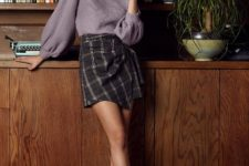 With bell sleeved sweater and gray ankle boots