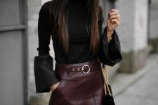 With black bell sleeved blouse, chain strap bag and black over the knee boots