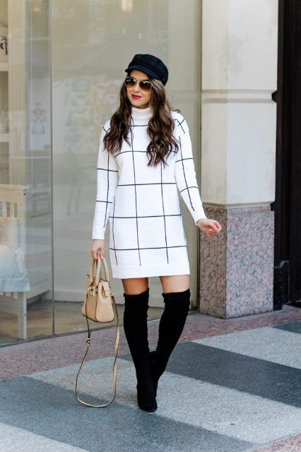 With black cap, beige bag and over the knee boots