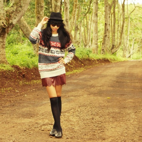 With black hat, printed loose sweater, shoes and black socks