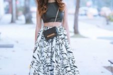 With black leather top and chain strap bag