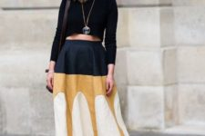 With black long sleeved top, bag and platform shoes