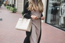 With black midi cardigan, white bag and black ankle boots