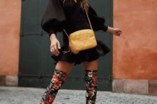 With black mini dress and yellow chain strap bag