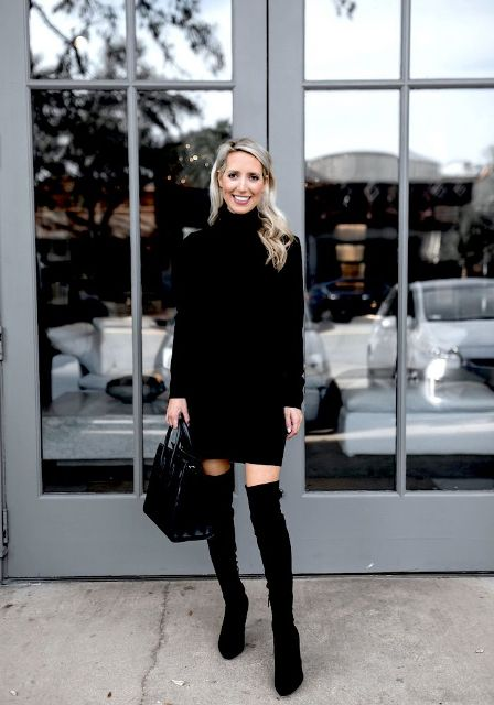 With black patent leather bag and black suede over the knee boots